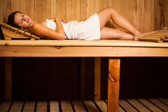 Woman relaxing in a sauna Royalty Free Stock Image