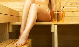 Woman relaxing in sauna. Royalty Free Stock Images