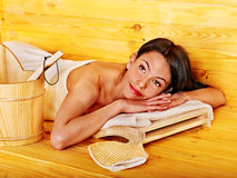 Woman relaxing in sauna. Royalty Free Stock Photos