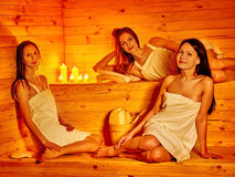 Woman relaxing in sauna Stock Photography