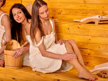 Woman relaxing in sauna Stock Photos