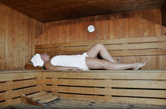 Woman relaxing in a sauna Stock Photography