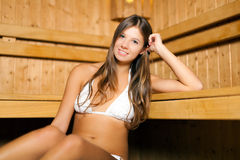 Woman relaxing in a sauna Royalty Free Stock Images