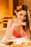Woman relaxing in sauna. Spa wellbeing. Stock Photo