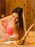 Woman relaxing in sauna. Spa wellbeing. Royalty Free Stock Photography