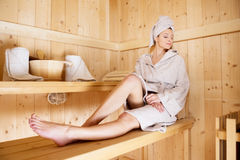 Woman relaxing in sauna Royalty Free Stock Image