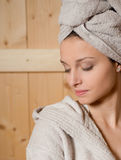 Woman relaxing in sauna Stock Photo