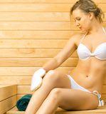 Woman relaxing in sauna. Stock Photography