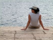 Woman relaxing by sea Royalty Free Stock Photos