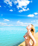 Woman relaxing by sea Royalty Free Stock Photo