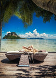 Woman relaxing by the sea at tropical resort Royalty Free Stock Photography