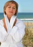Woman relaxing by the seaside Stock Photography