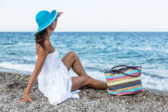 Woman relaxing at a seaside. Stock Photography
