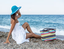 Woman relaxing at a seaside. Stock Images
