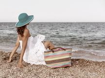 Woman relaxing at the seaside. Stock Photography