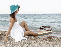 Woman relaxing at the seaside. Stock Photo