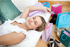 Woman relaxing after shopping surrounded with shop Royalty Free Stock Photography