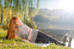 Woman relaxing on the shore of Lake Royalty Free Stock Image
