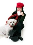 Woman relaxing with a small pet dog Royalty Free Stock Photography