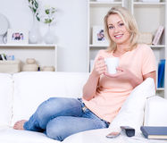 Woman relaxing on the sofa stock image