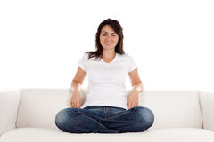 Woman relaxing on sofa Stock Images