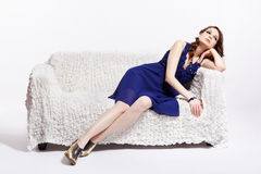 Woman relaxing on sofa Stock Image