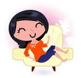 Woman relaxing in sofa Stock Image