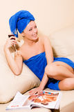Woman relaxing on the sofa Royalty Free Stock Images