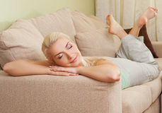 Woman relaxing on a sofa Royalty Free Stock Image