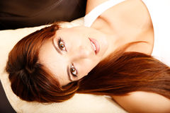 Woman relaxing on a Sofa Royalty Free Stock Photo