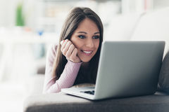 Woman relaxing on the sofa Stock Images