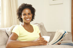 Woman Relaxing On Sofa At Home Royalty Free Stock Image