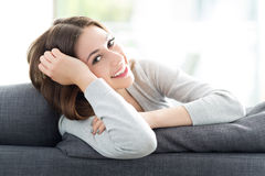 Woman relaxing on sofa Royalty Free Stock Photo