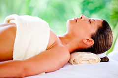 Woman relaxing at a spa Royalty Free Stock Images