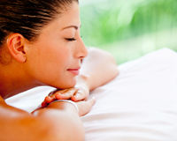 Woman relaxing at a spa Royalty Free Stock Photos