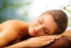 Woman relaxing in a spa Royalty Free Stock Photos