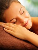 Woman relaxing in a spa Stock Images