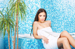 Woman relaxing in spa center Stock Images