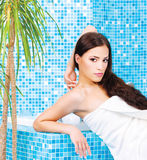 Woman relaxing in spa center. Pretty woman relaxing in spa center stock photography