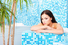Woman relaxing in spa center Royalty Free Stock Image
