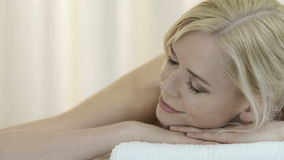 Woman relaxing at spa stock footage