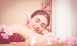 Woman is relaxing in Spa in dreamy color tone royalty free stock photography