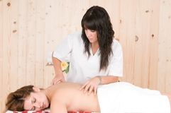 Woman relaxing in spa getting massage Stock Image