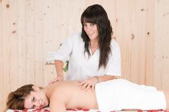 Woman relaxing in spa getting massage Stock Photos