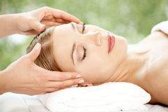 Woman relaxing at spa having a facial Royalty Free Stock Photos