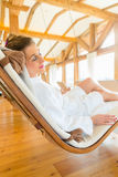 Woman relaxing on spa lounger Stock Photos