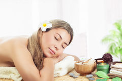 Woman relaxing at spa Stock Images