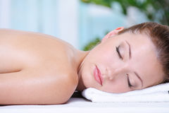 Woman relaxing in the spa salon Stock Photography