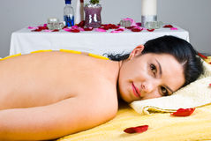 Woman relaxing at spa salon. Beautiful woman relaxing at spa salon and having slices lemon on her back skin,check alsoSpa,aromatherapy ,massage Royalty Free Stock Photos