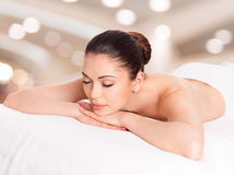 Woman relaxing in spa salon. Adult beautiful woman relaxing in spa salon royalty free stock photography